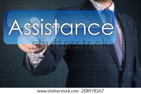 Businessman pressing high tech type of modern Assistance button  - stock photo