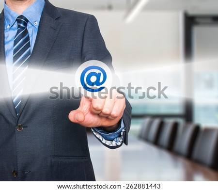 Businessman pressing mail button on visual screen. Customer support concept. Isolated on office background.  - stock photo
