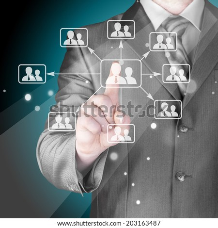 Businessman pressing modern social buttons - stock photo