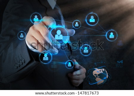 Businessman pressing modern social buttons on a virtual computer - stock photo