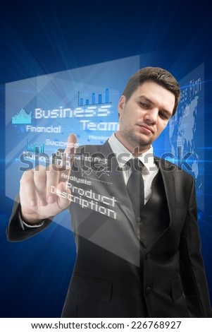 businessman pressing modern touch screen buttons with a blue technology background,business concept  - stock photo