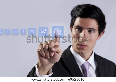 Businessman pressing on digital screen buttons on the whiteboard (selective focus) - stock photo
