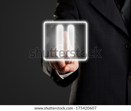 Businessman pressing pause button on virtual screen - stock photo