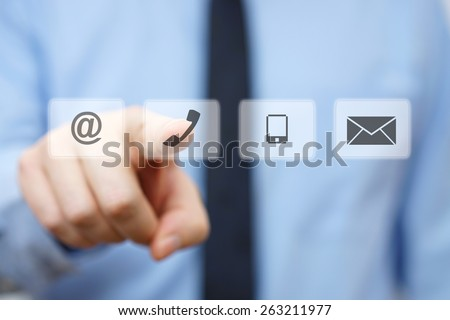 businessman pressing phone button, company identification icons - stock photo