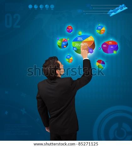 Businessman pressing pie chart button, futuristic technology - stock photo
