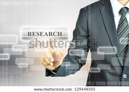 Businessman pressing RESEARCH sign - stock photo