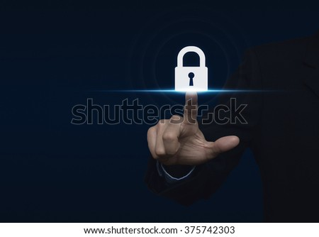 Businessman pressing security button icon, Technology information security and data encryption concept - stock photo