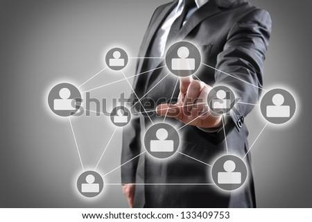 Businessman pressing social media icon - stock photo