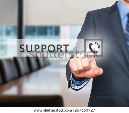 Businessman pressing support button on virtual screens. Isolated on office. Business, technology, internet and networking concept. Stock Image - stock photo