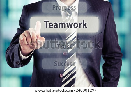 Businessman pressing teamwork button at his office. Teamwork concept, toned photo. - stock photo