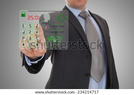 Businessman pressing the security code - stock photo