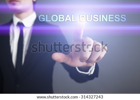 """Businessman pressing touch screen interface and select """"Global business"""". Business concept. Internet concept. - stock photo"""
