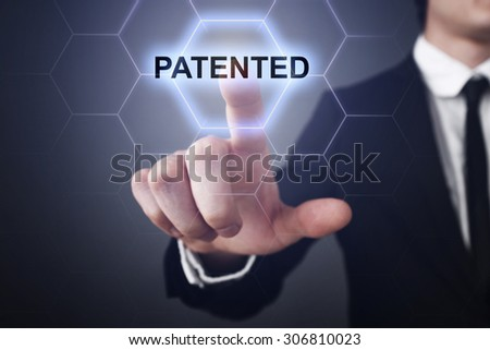 """Businessman pressing touch screen interface and select icon """"patented"""". Business concept. Internet concept. - stock photo"""