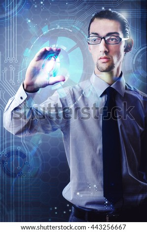 Businessman pressing virtual button in futuristic concept - stock photo