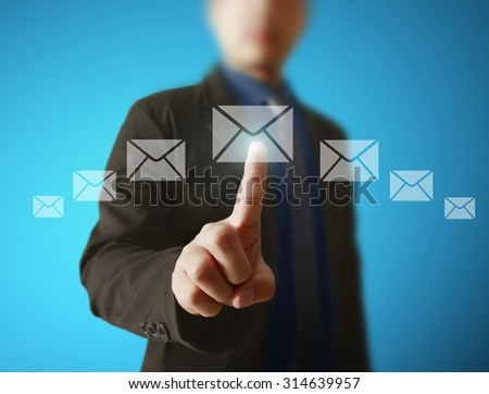 Businessman pressing virtual icons, technology concept - stock photo