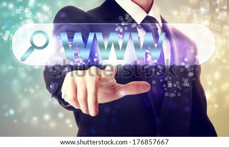 Businessman pressing WWW search button on shiny background - stock photo