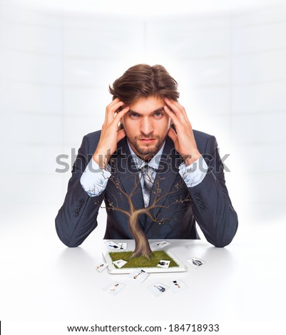 businessman problem, negative emotion concept, dried tree without leaf grow from tablet screen, business man team crisis, human resources people photo fall off - stock photo