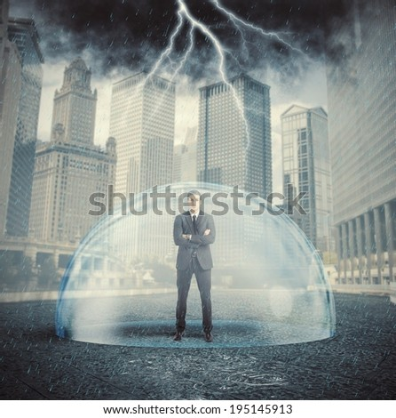 Businessman protected from the crisis with a crystal ball - stock photo
