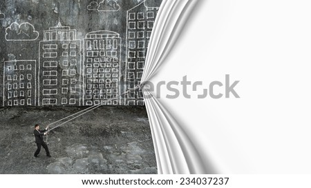 businessman pull blank white curtain covered old dirty cityscape doodles concrete wall background - stock photo