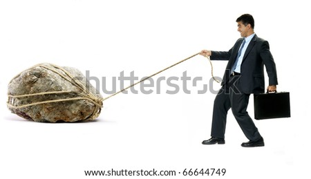 Businessman pulling a big white hanging a black suitcase. - stock photo