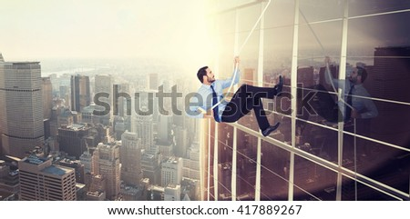Businessman pulling a rope with effort against image of a city landscape on a sunny day - stock photo