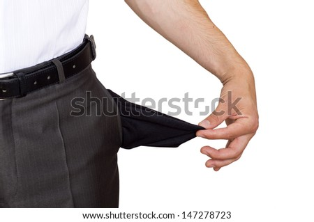 Businessman pulling out his empty pocket in despair - stock photo