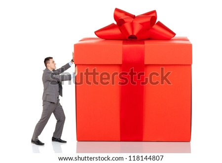 Businessman push big gift box full length concept. Business man present red gift box with ribbon bow Isolated over white background - stock photo