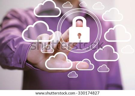 Businessman push sign button web cloud lock icon - stock photo