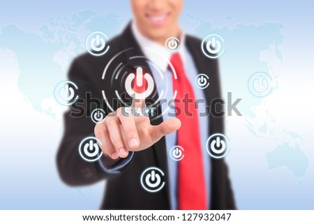 businessman push the start button on virtual touch pad - stock photo