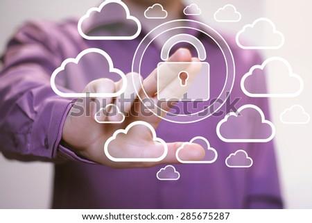 Businessman push web button cloud lock virtual sign - stock photo