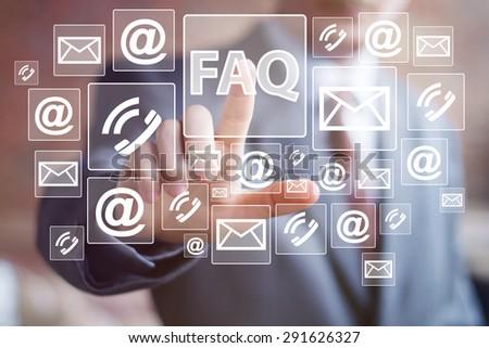 Businessman push web button FAQ network communication - stock photo