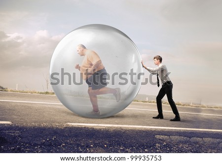 Businessman pushing a bubble with fat man running in it - stock photo