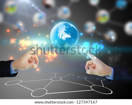 Businessman pushing business world - stock photo