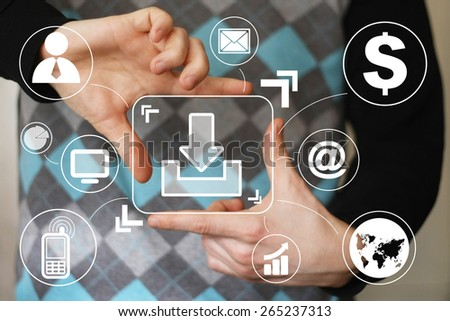 Businessman pushing button download virtual - stock photo
