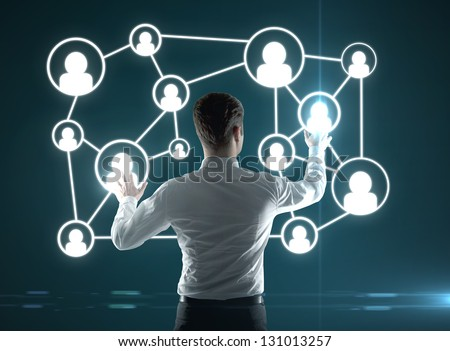 businessman pushing interface with social icons - stock photo