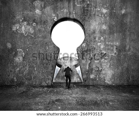 Businessman pushing keyhole door with city buildings view on mottled concrete wall background - stock photo