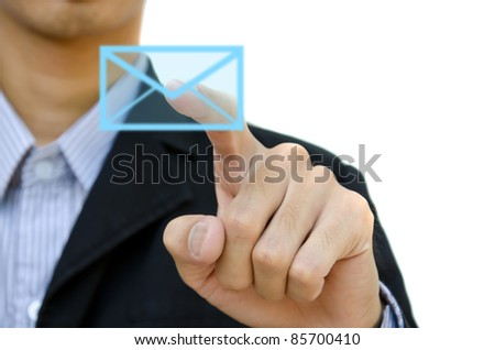 businessman pushing mail for social network on a touch screen interface. - stock photo