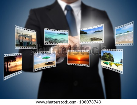 Businessman pushing many image film button on the whiteboard. - stock photo
