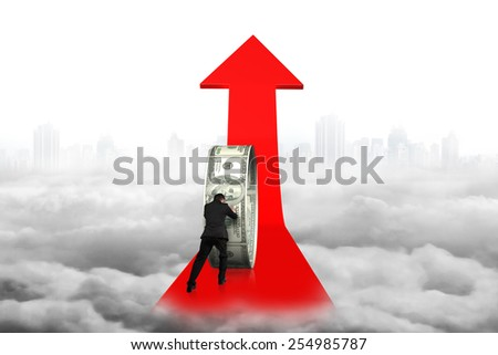 Businessman pushing money circle on red arrow with cityscape cloudscape background - stock photo