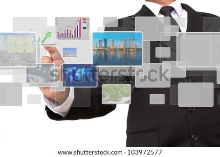 businessman pushing on a touch screen interface - stock photo