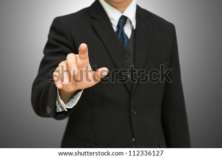 Businessman pushing on the whiteboard with clipping path - stock photo