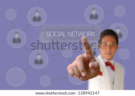 Businessman pushing Social Network button on the blue background - stock photo