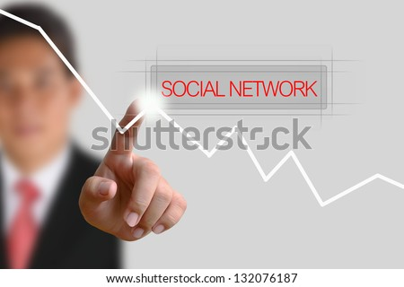 Businessman pushing Social Network button on the white background - stock photo