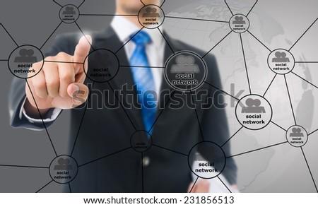 Businessman Pushing Social Network diagram. - stock photo