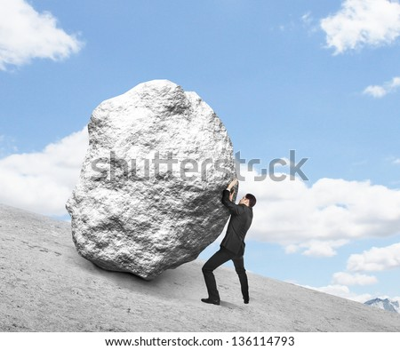 businessman pushing stone up hill and sky - stock photo