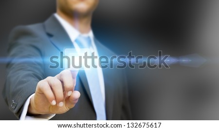 Businessman pushing tactile button - stock photo