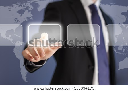 Businessman pushing virtual button on a modern device using touch screen technology with a world map background - stock photo