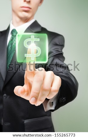 Businessman pushing virtual button with dollar sign. - stock photo