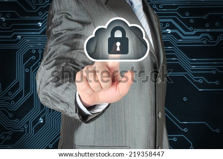 Businessman pushing virtual cloud security button on digital background - stock photo
