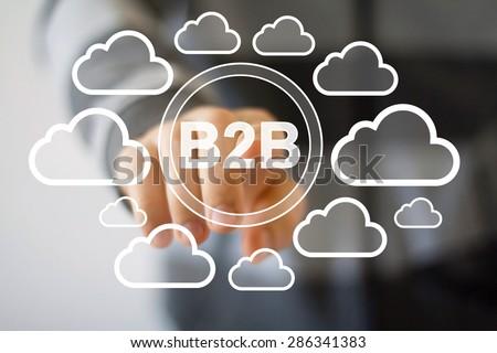 Businessman pushing web button B2B cloud symbol - stock photo